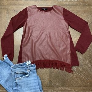 Burgundy sweater with leather front with fringe.